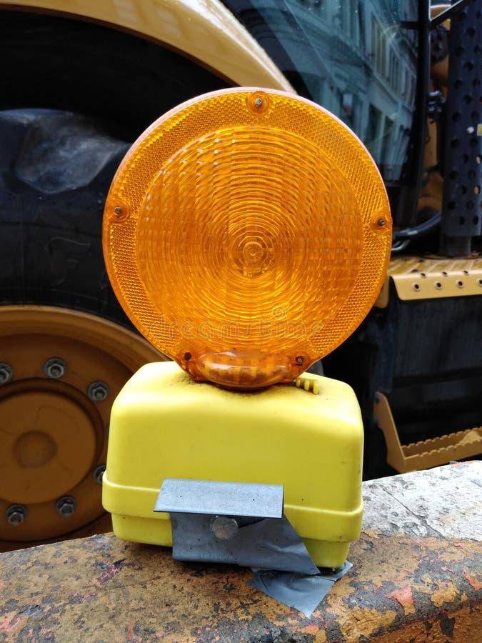 Barricade Light, Construction Site, NYC, NY, USA. Barricade light orange battery power powered yellow led flash flashing steady burn safety barricades barrier royalty free stock photos