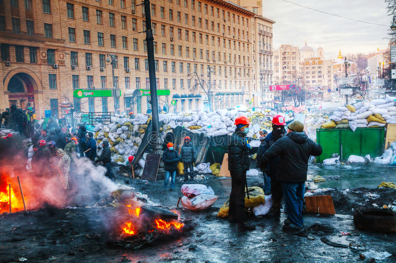 Barricades with the protesters at Hrushevskogo street in Kiev. KIEV, UKRAINE - JANUARY 24: Overview of the barricade with the protesters at Hrushevskogo street stock photo
