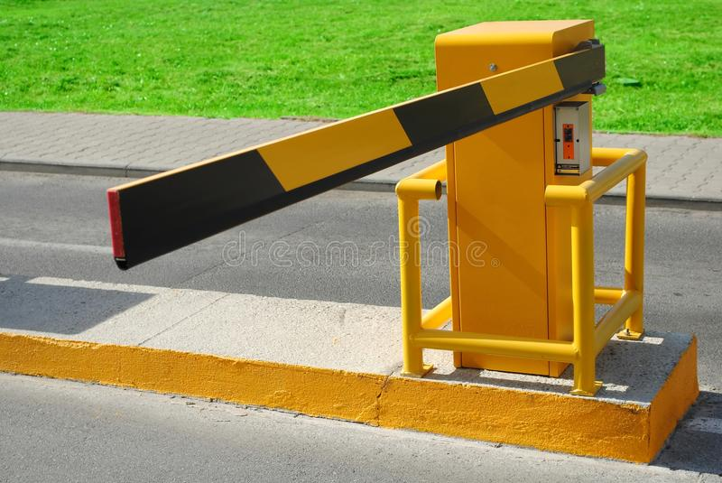 Barrier. Entrance barrier,yellow and black security gate stock photography