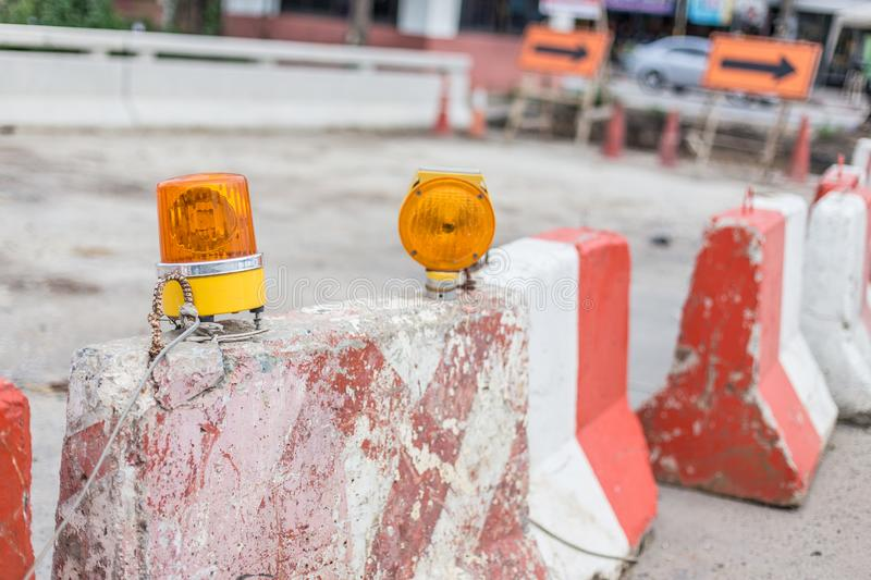 Barrier and siren in the road  construction area. Barrier and siren in the road construction area stock image