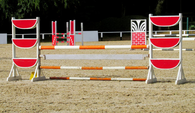 Barrier to jump on horse at the racetrack royalty free stock image