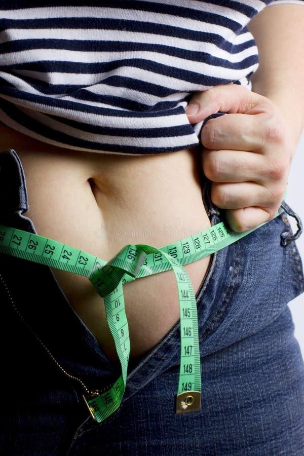 Barriga gorda da mulher imagem de stock royalty free