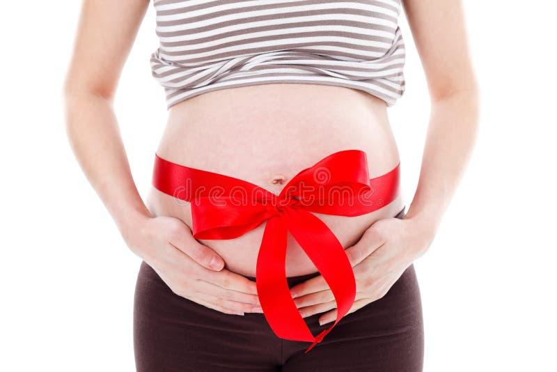 Barriga grávida com fita fotos de stock royalty free