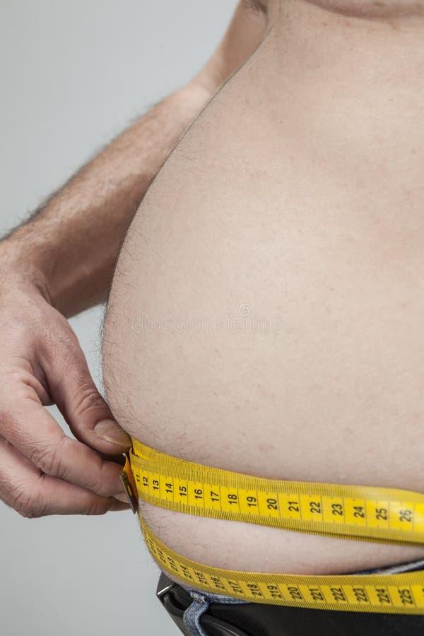 Download Barriga Grande De Um Homem Gordo Foto de Stock - Imagem de linha, mão: 29826214