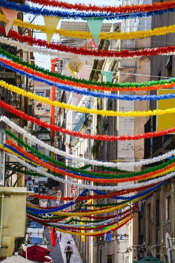 Barrio Alto Lisbon. Streamers across a narrow Alley in Lisbon's Barrio Alto royalty free stock image