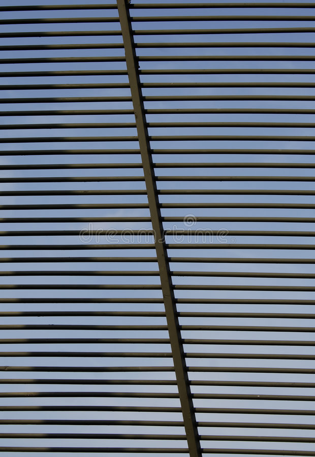 Bars. Grating in window, sky sees from for bars stock photo