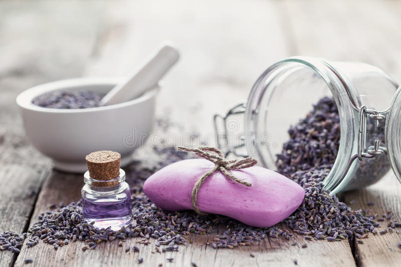 Bars of homemade soaps, dry lavender flowers and essential oil royalty free stock photography
