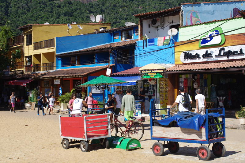 Bars and restaurants on the beach. Bars, restaurants and hotels in Vila do Abraao on the island of Ilha Grande in Brazilian green coast south of Rio de Janeiro stock photo