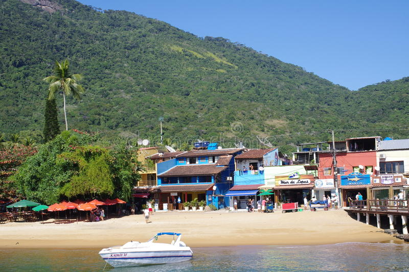 Bars and restaurants on the beach. Bars, restaurants and hotels in Vila do Abraao on the island of Ilha Grande in Brazilian green coast south of Rio de Janeiro stock images