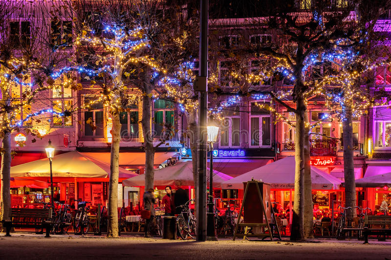 Bars and restaurants with christmas lights on the famous Vrijthof square in Maastricht royalty free stock images