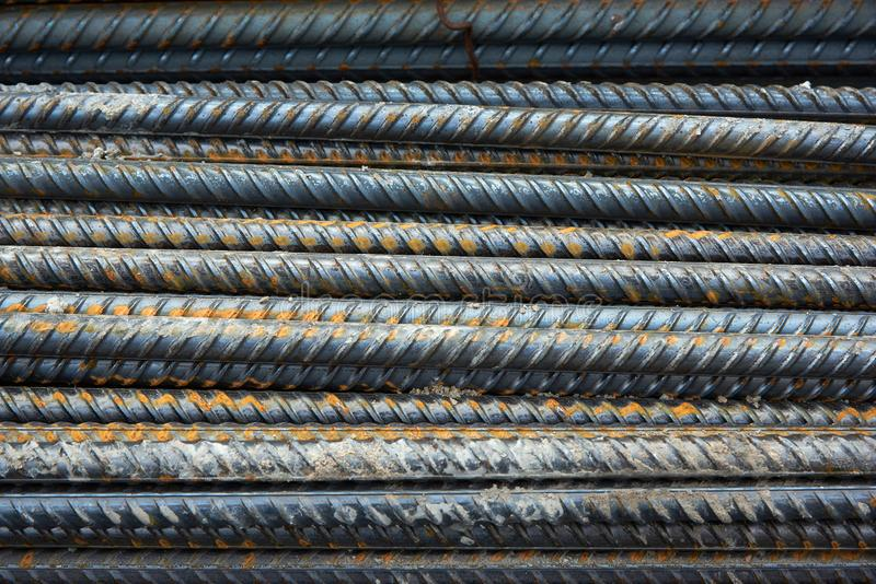 The bars of the rusty steel fittings. Construction of a textured background stock photos