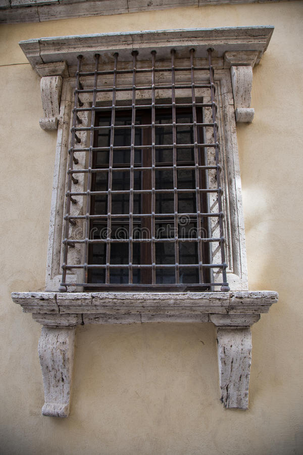 Bars on the window. Inglese Italiano Old window with bars stock images