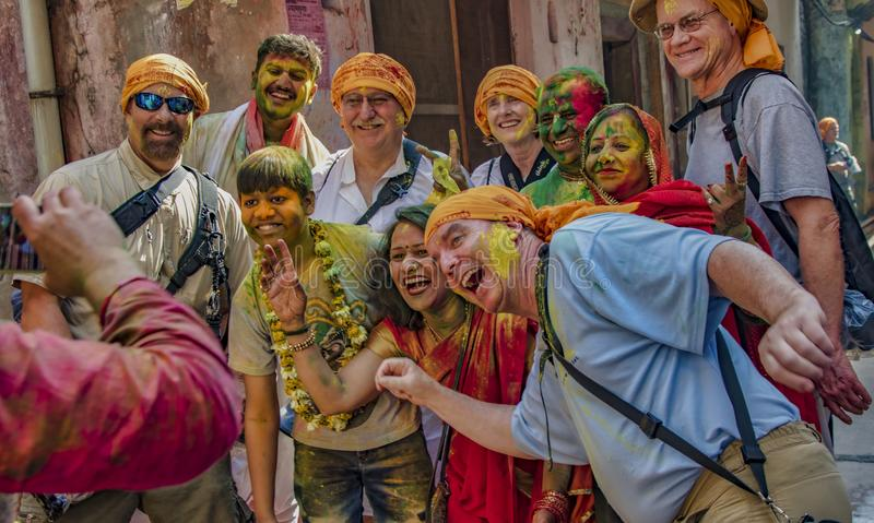 Barsana, India / February 23, 2018 - Tourists and locals share a group photo in the Holi festival royalty free stock images