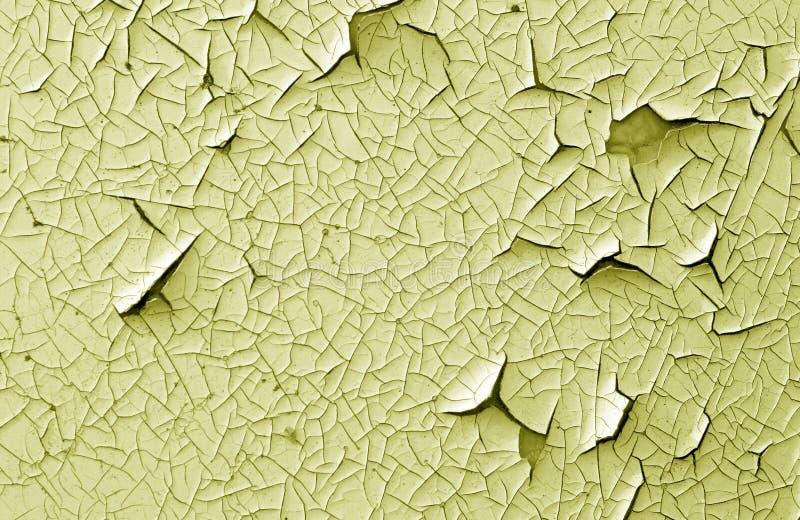 Barst en schade op geschilderde textuur in gele toon royalty-vrije stock foto