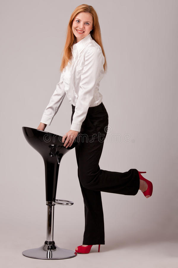 Barstool and businesswoman stock image