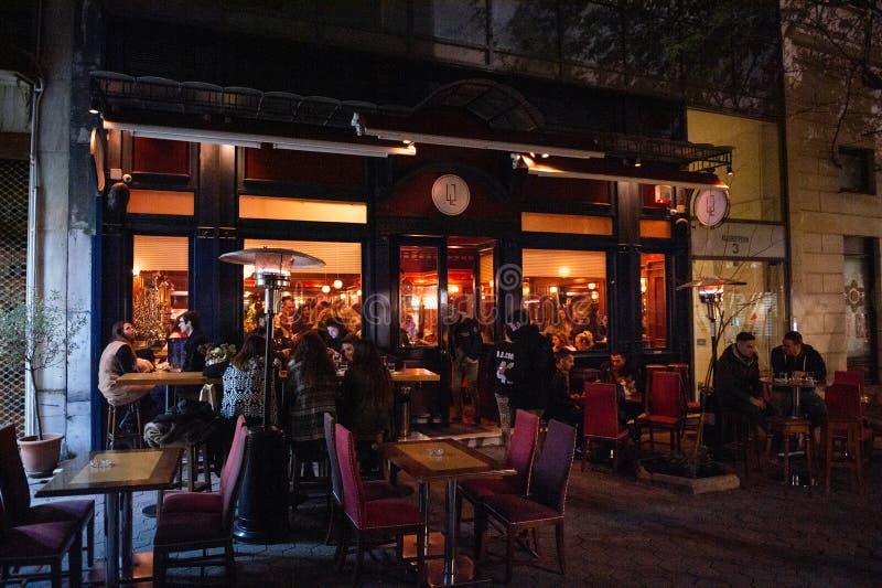 42 Barstronomy on Kolokotroni street at night with customers royalty free stock images