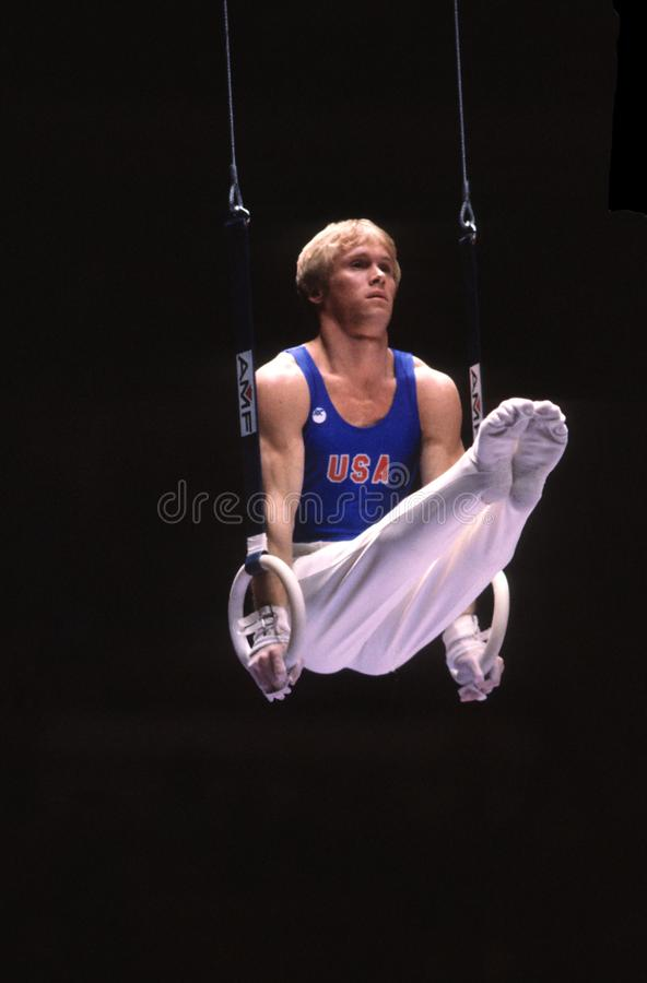 Bart Connor USA Gymnast. Bart Connor USA Gymnast on the rings in competition royalty free stock photography