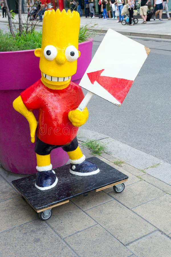 Bart Simpson mascot on skateboard. Bart Simpson on skateboard - street advertising mascot royalty free stock image