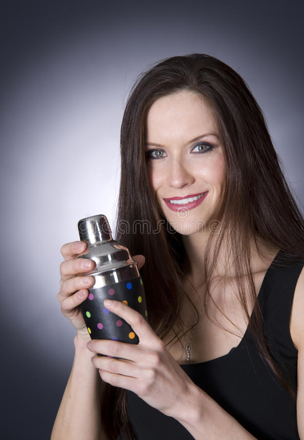 Attractive Bartender Uses Shaker Mix Drinks stock image