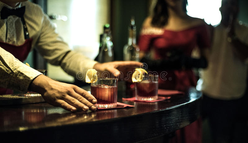 Bartender in the bar stock photography