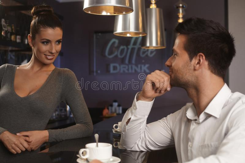 Download Bartender Flirting With Young Man In Bar Stock Photo - Image of coffee, 25: 35810442
