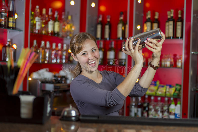 Bartender makes cocktail stock photo
