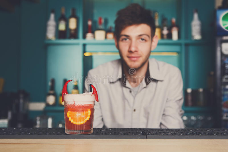 Bartender offers exotic spicy alcoholic cocktail stock photos
