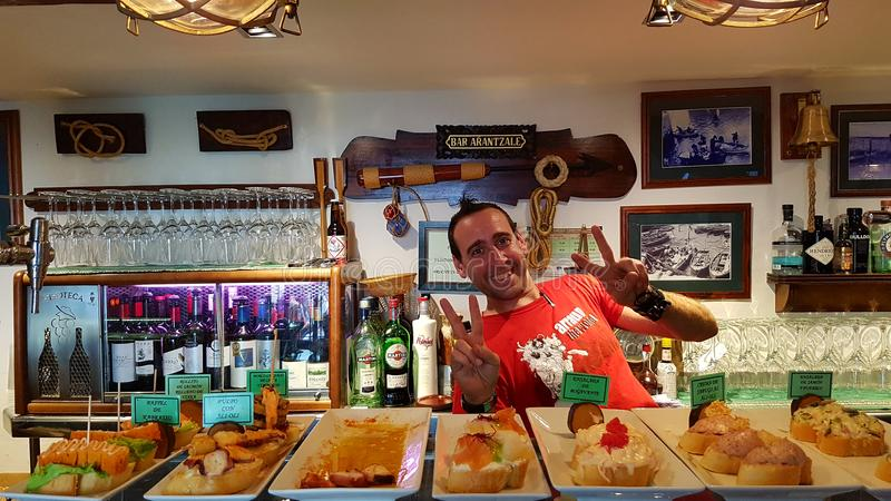 Bartender and pinchos stock photography