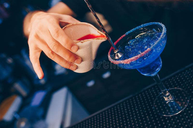 Bartender pouring using strainer. Trendy stylish club alcoholic Sweet healthy Cocktail on a bar counter view .  Copy paste for. Design people and luxury concept royalty free stock images