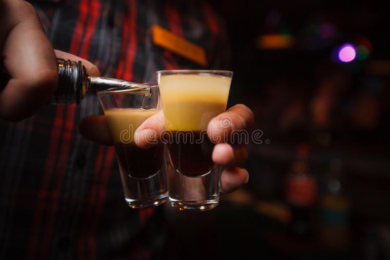 bartender pours a cocktail b 52 close-up stock photography