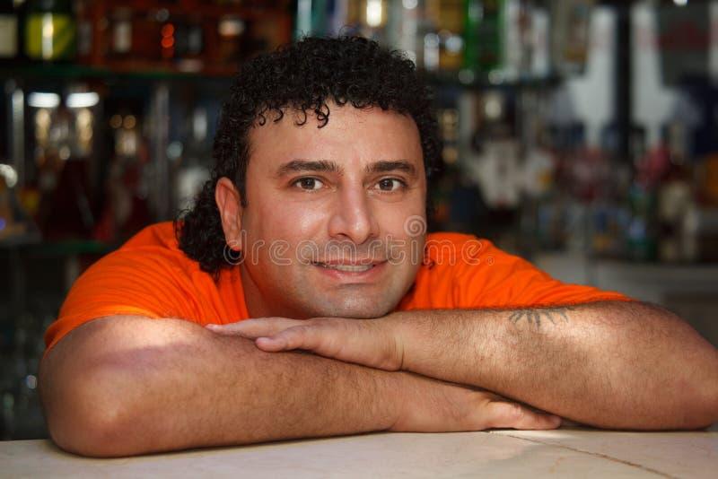 Download Bartender Sits At Bar Royalty Free Stock Image - Image: 13301086