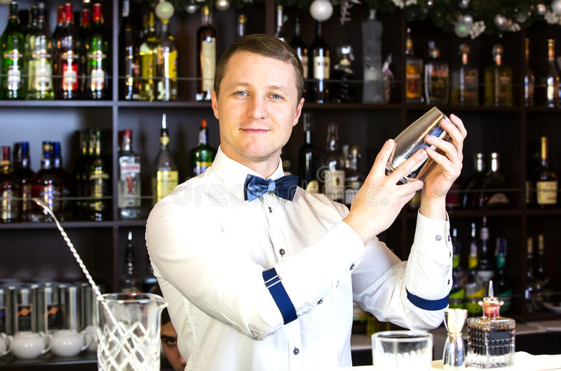 Bartender. Young man working as a bartender in a nightclub bar stock photography