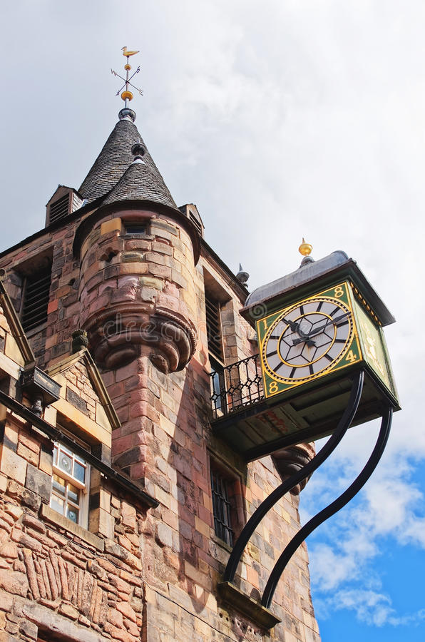 Bartizans and Clock of Canongate tolbooth in the Royal Mile. Bartizans and Clock of Canongate tollbooth in the Royal Mile of the Old Town of Edinburgh in stock photo