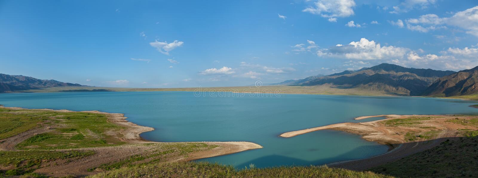 Bartogai dam on a mountain river Chilik, Kazakhstan upcast of wa stock photo