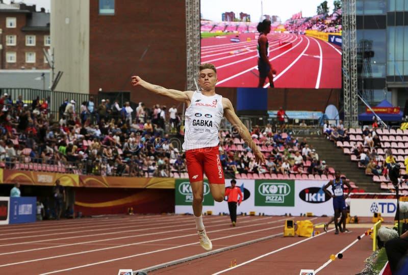 BARTOSZ GABKA DE POLOGNE sur l'événement de long saut aux championnats du monde U20 d'IAAF à Tampere, photos libres de droits