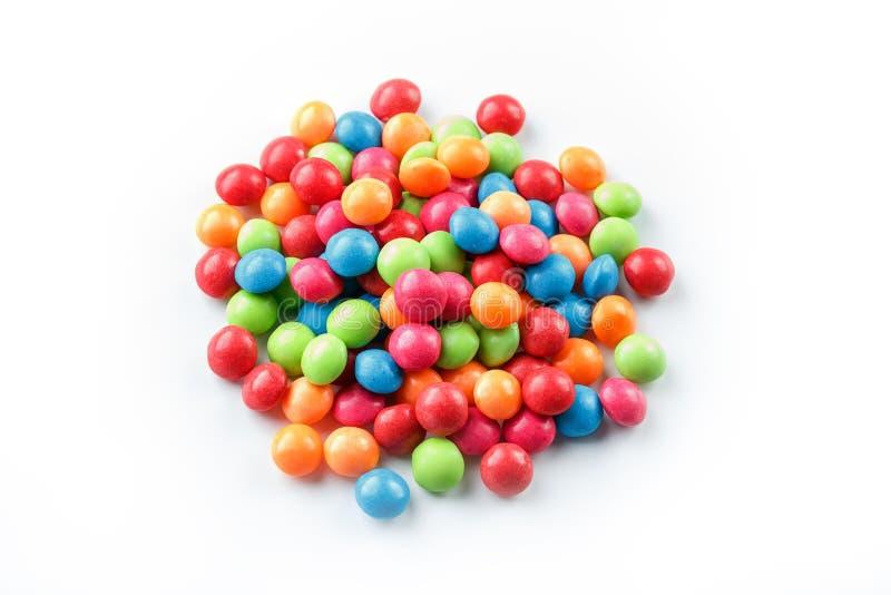 Barwiący cukierki, stubarwni w górę, tekstura i powtórka dragee zdjęcia royalty free