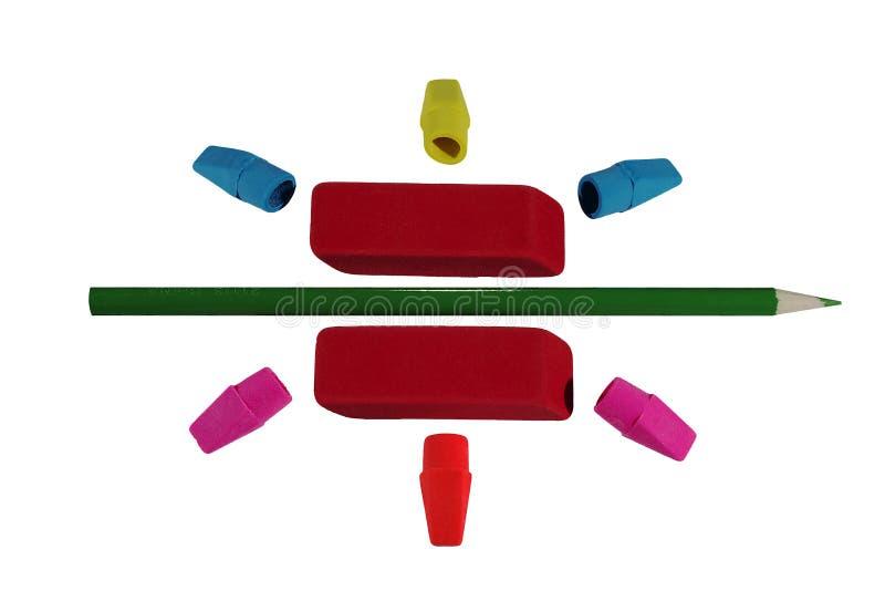 Barwione gumki z zielonym ołówkiem obrazy stock