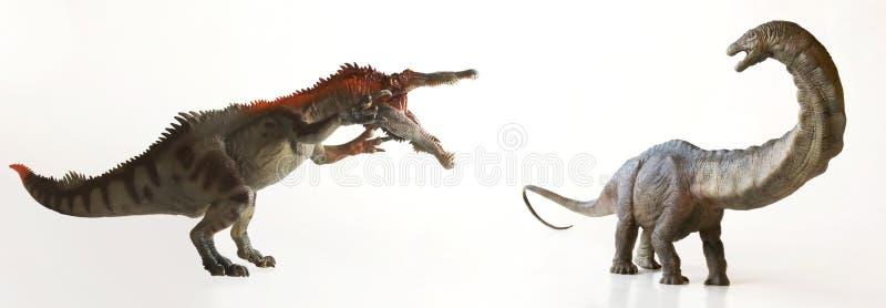 Baryonyx恐龙恐吓一只食草蜥脚类动物 库存图片