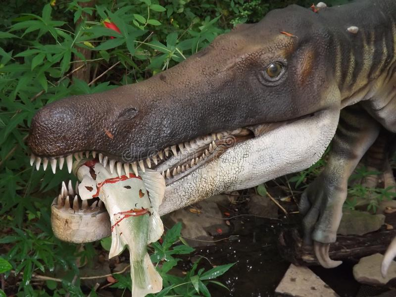 Baryonyx Dinosaur With Fish. Dino taken at display in Birmingham Zoo stock photos