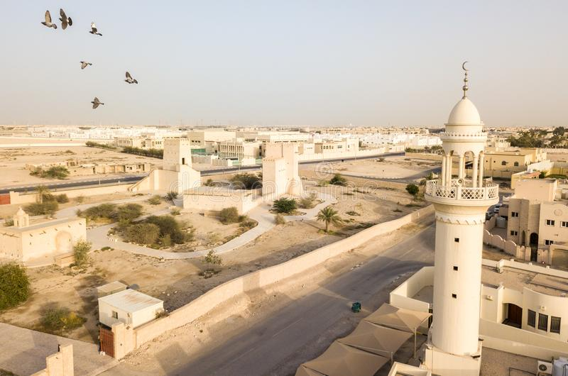 Barzan old watchtowers and a modern mosque. Old Ancient Arabian fortification, Qatar. Middle East. Persian Gulf. stock images