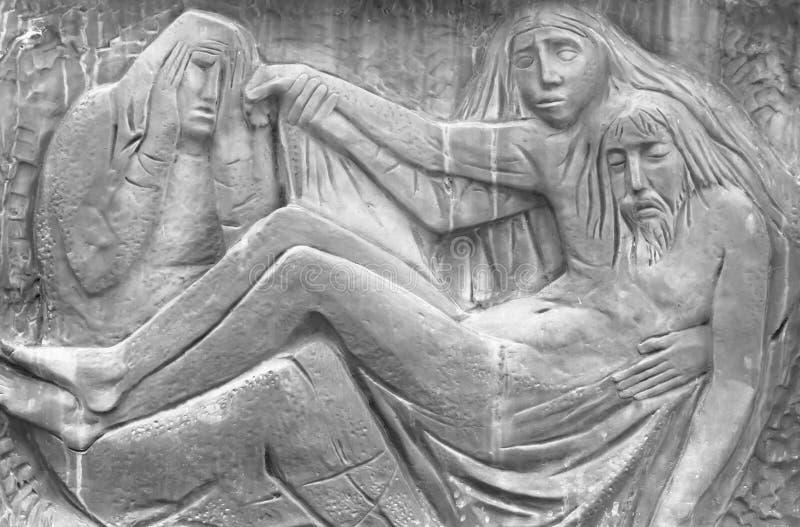 Bas-ανακούφιση που αντιπροσωπεύει τον οίκτο Michelangelo στοκ εικόνες