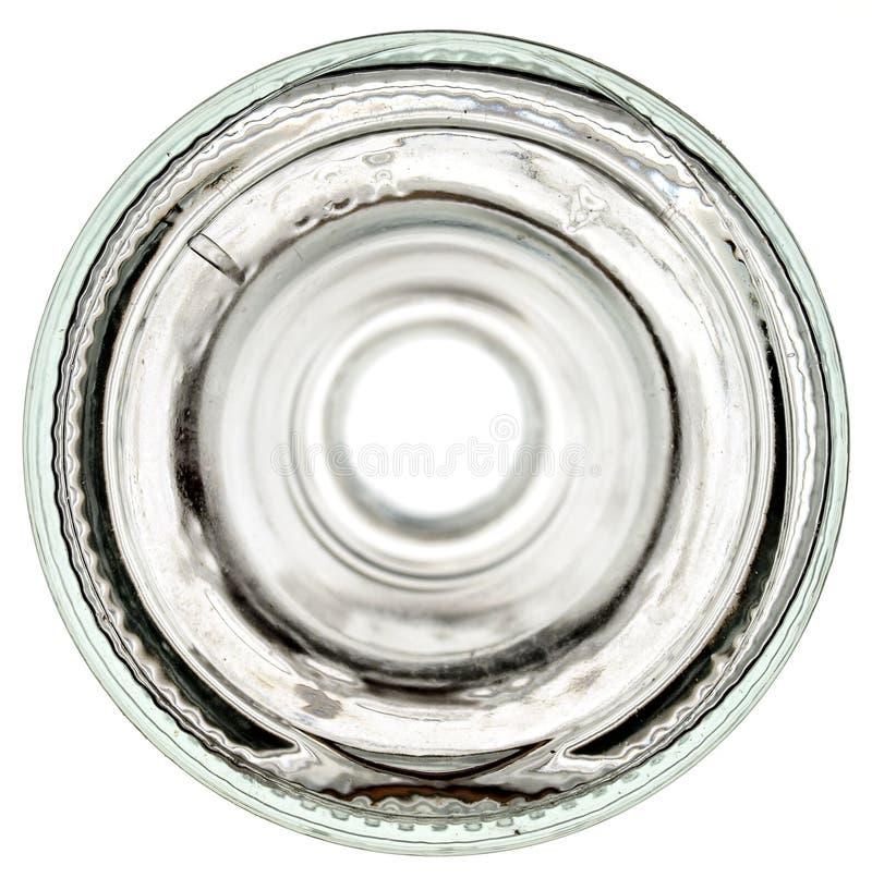 Bas d'une bouteille en verre sur un fond blanc images stock