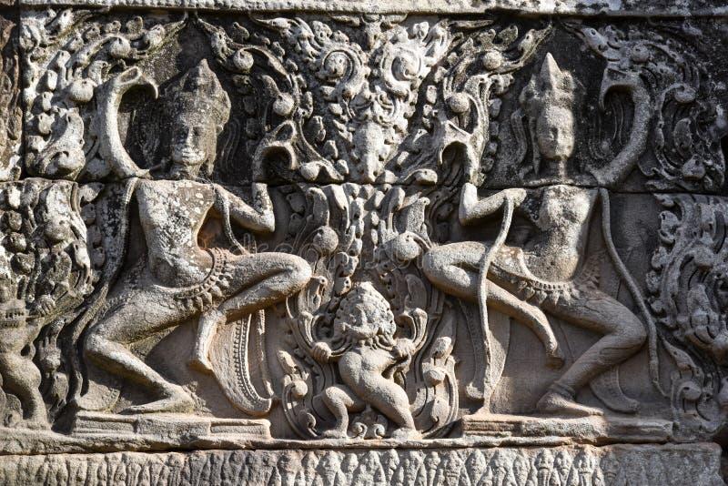 Bas lättnad av den Bayon templet, Angkor Thom, Siem Reap, Cambodja royaltyfri bild