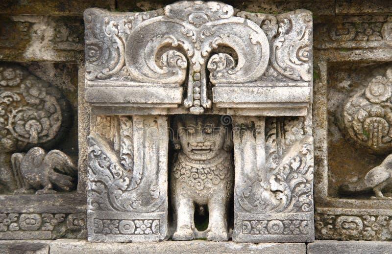 Bas-relevo de pedra antigo, templo Borobudur de Buddist, Yogyakarta imagens de stock royalty free