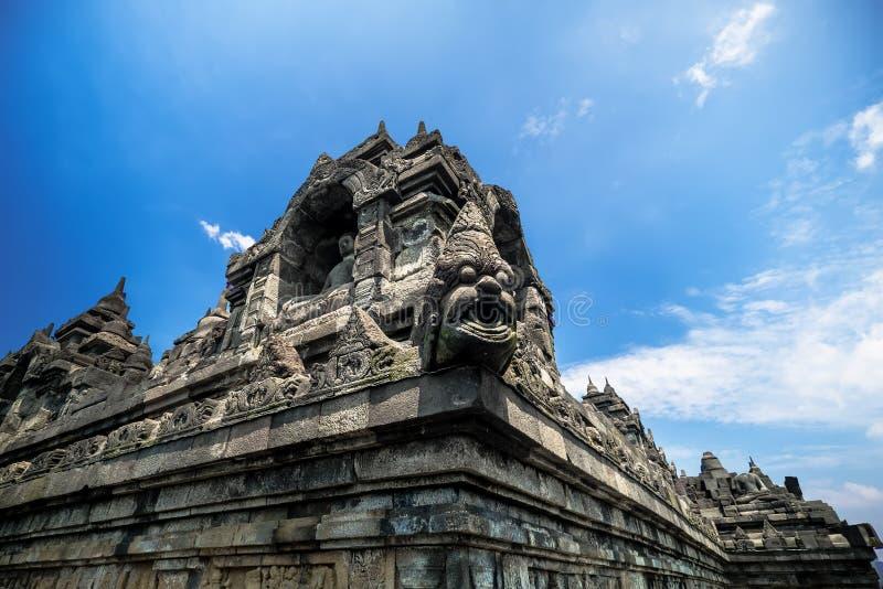 Bas-relevos antigos do templo budista de Borobudur Java, Indones fotos de stock