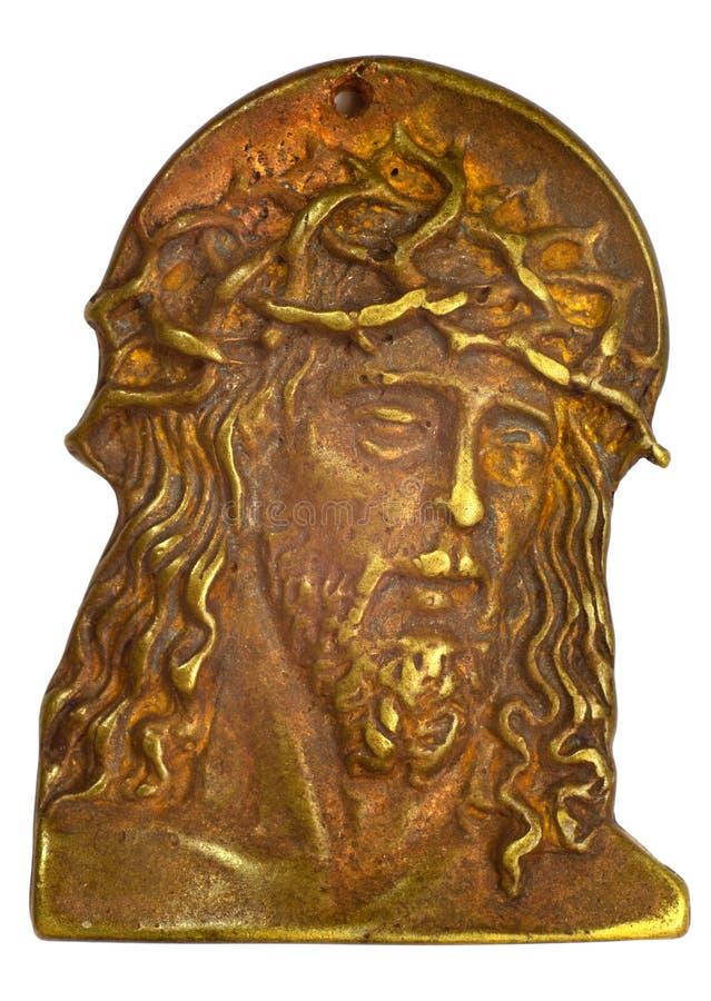 Bas-relief de bronze com cabeça do Jesus Cristo imagem de stock