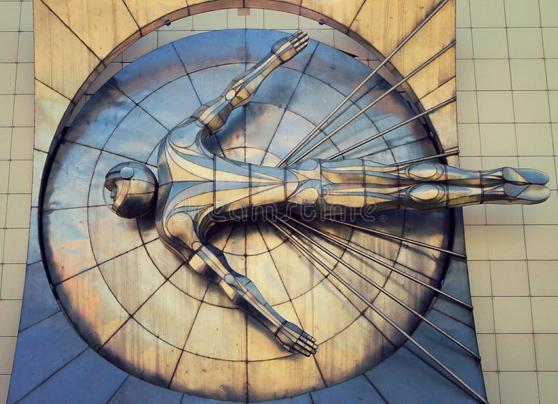 Bas-relief depicting a flying astronaut stock photo