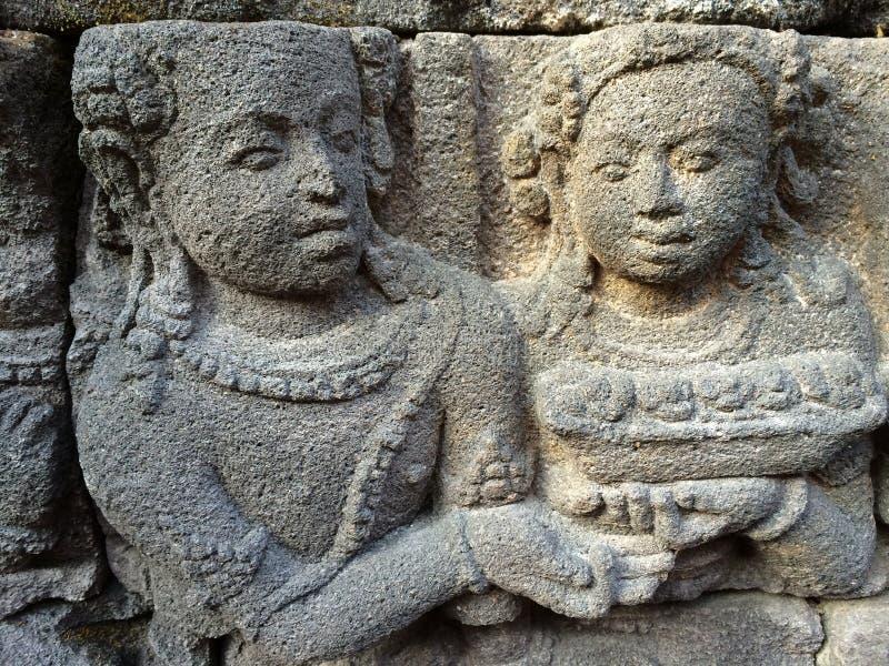 Bas Relief die het verschillende stadium van het leven van Lord Buddha naar Nirvana tonen, Borobudur-Tempel, Centraal Java, Indon stock fotografie