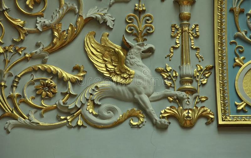 Gryphon mythological creature. Bas-relief Gryphon mythological creature lion with an eagle`s head and wings royalty free stock images