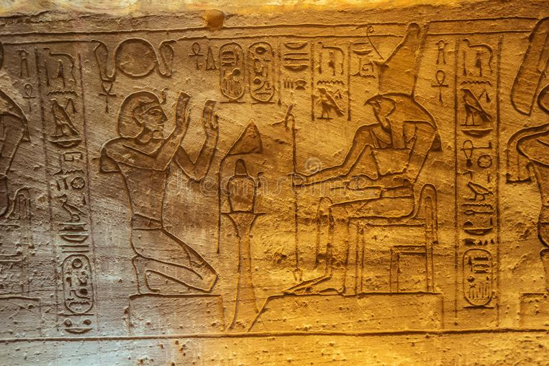 Bas relief of the Ramesses II and Horus royalty free stock photography